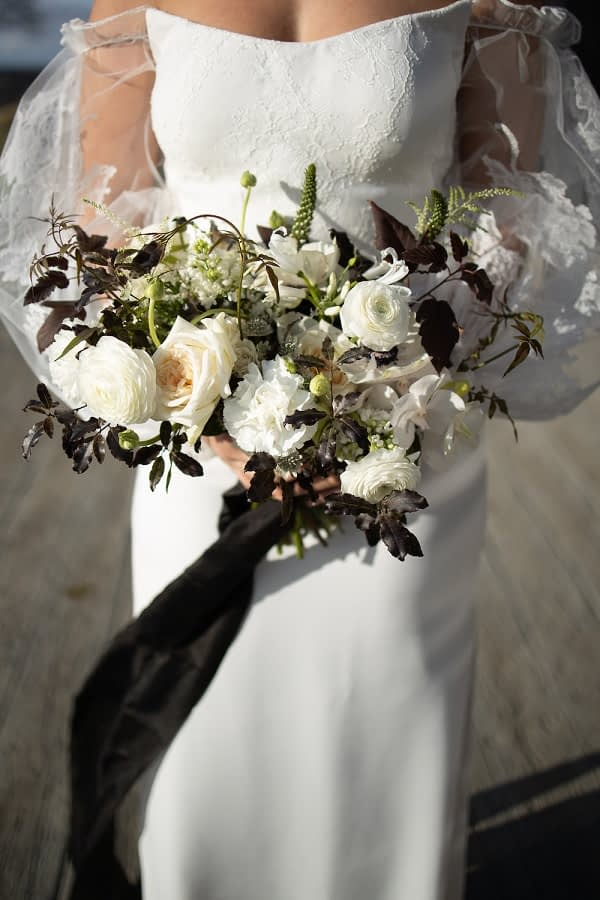 Monochrome wedding bouquet with white roses
