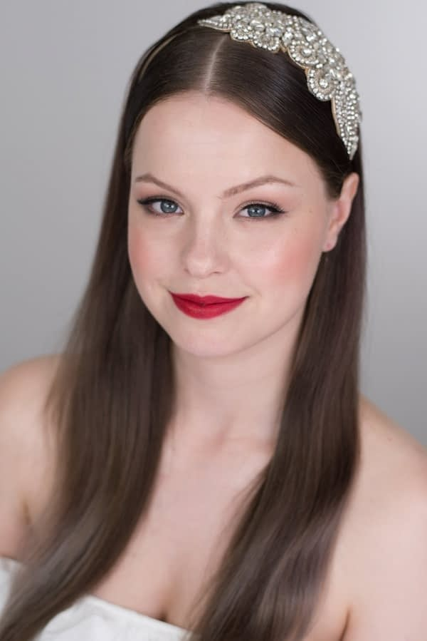 Sleek bridal hairstyle natural makeup for porcelain skin tone red lip