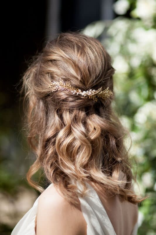 Romantic hair half up half down with gold leafy headpiece