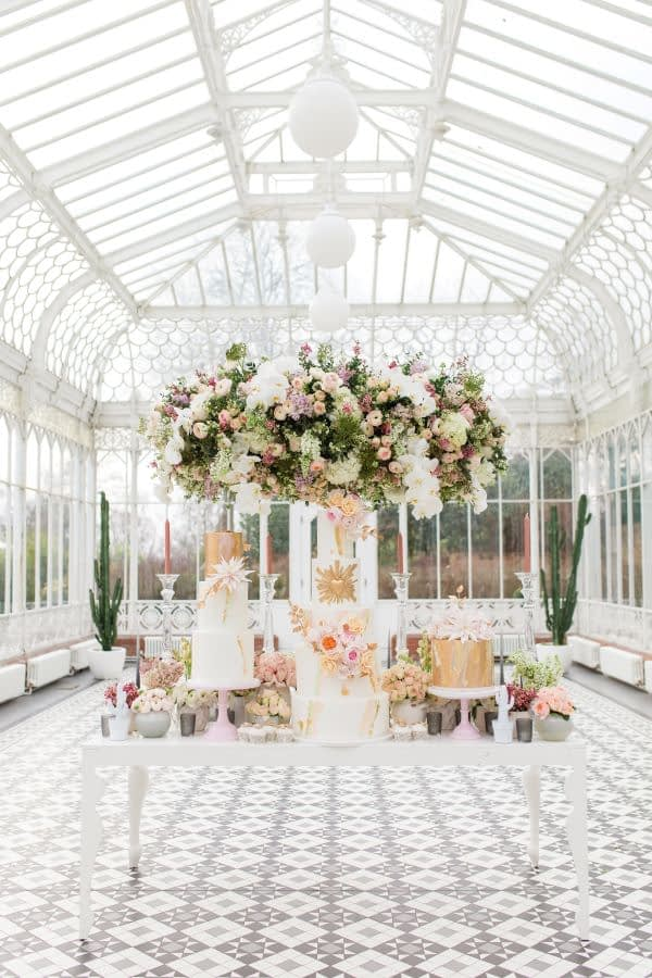 """wedding cake and floral installation in Horniman Museum and gardens Conservatory"""