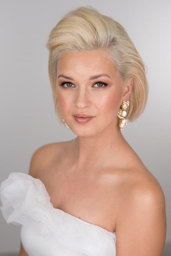 Golden and bronze tone makeup for a wedding day modern bride wearing strapless wedding dress