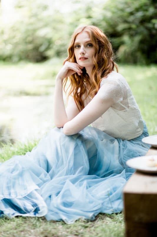 Bridal makeup and hair for red hair two piece dress with blue skirt
