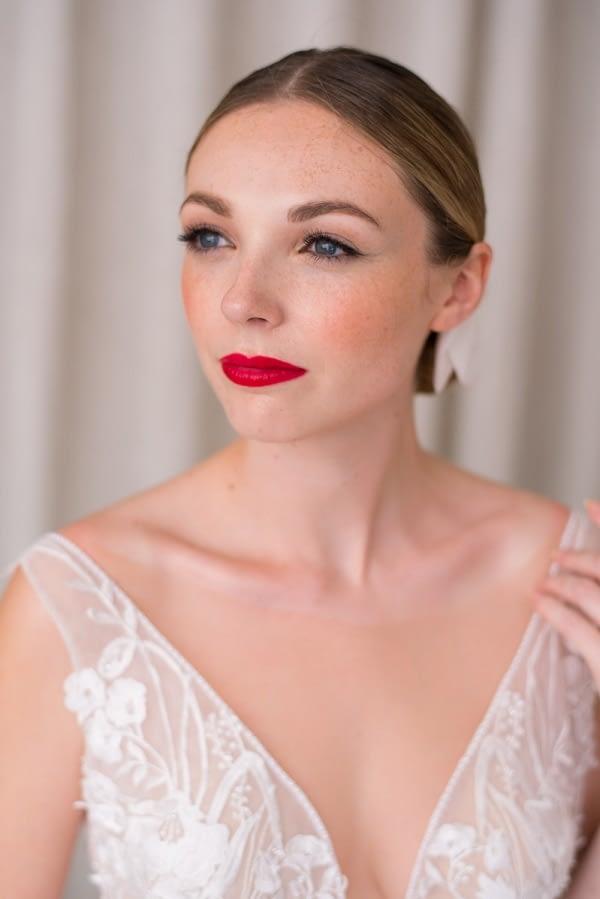 Sleek bridal hairstyle natural makeup for pale skin tone red lip
