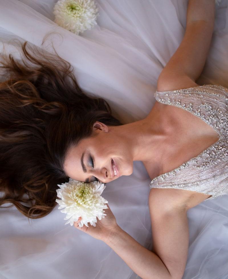 Smokey eyes for a wedding day bride with long hair wearing wedding dress