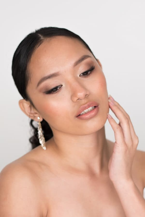 Asian mono lid eye makeup for wedding day nude lips bride wearing a sleek hairstyle for a wedding