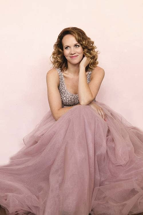 mother of the bride makeup natural and youthful look pink dress wedding gown