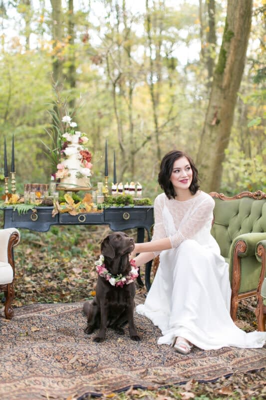 Loseley-Park Bride with short hair and berry lipstick in a woodland setting