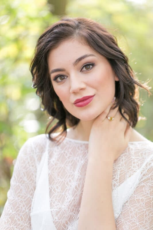 Bride with short hair and berry lipstick in a woodland setting
