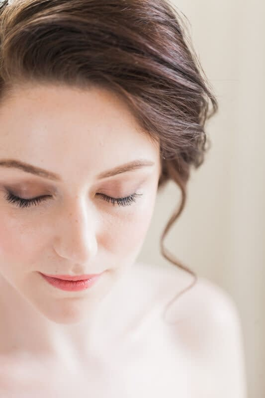 Bride wearing soft bridal makeup look very pale skin makeup