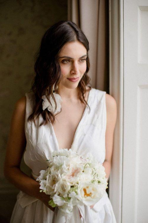 Morden Hall wedding bride looking outside the window long hair no makeup makeup look