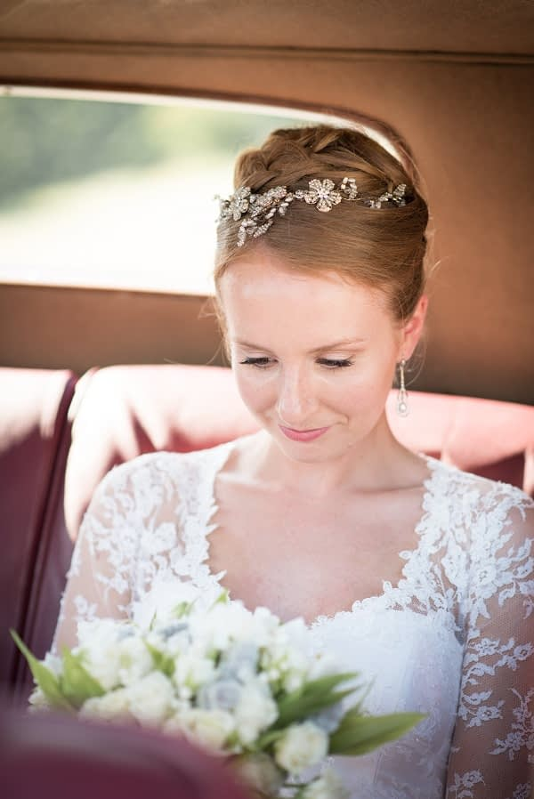 Bride sitting in a car wearing a natural bridal makeup