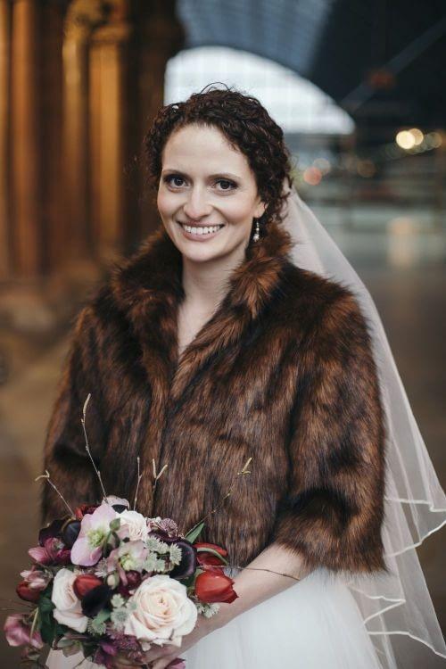 Bride wearing a short faux fur for winter wedding London natural bridal makeup chic bridal fur-cruelty-free-bridal-makeup-atrist