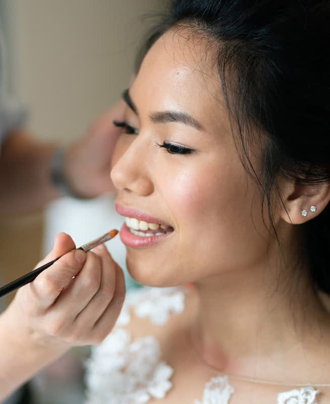Hooded eyes bridal makeup for Asian bride getting ready for a wedding day