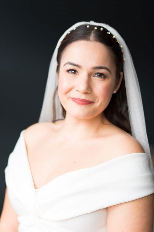 Natural bridal makeup look with sleek hair down veil with pearl headband