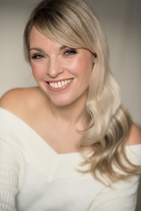 smiling mature bride wearing natural glowing makeup and soft Hollywood waves