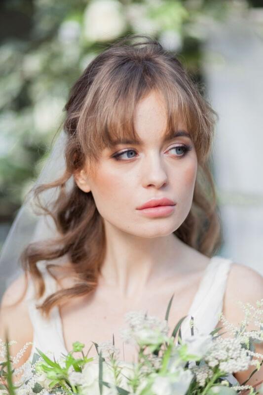 Romantic portrait of a bride wearing soft smokey eye makeup
