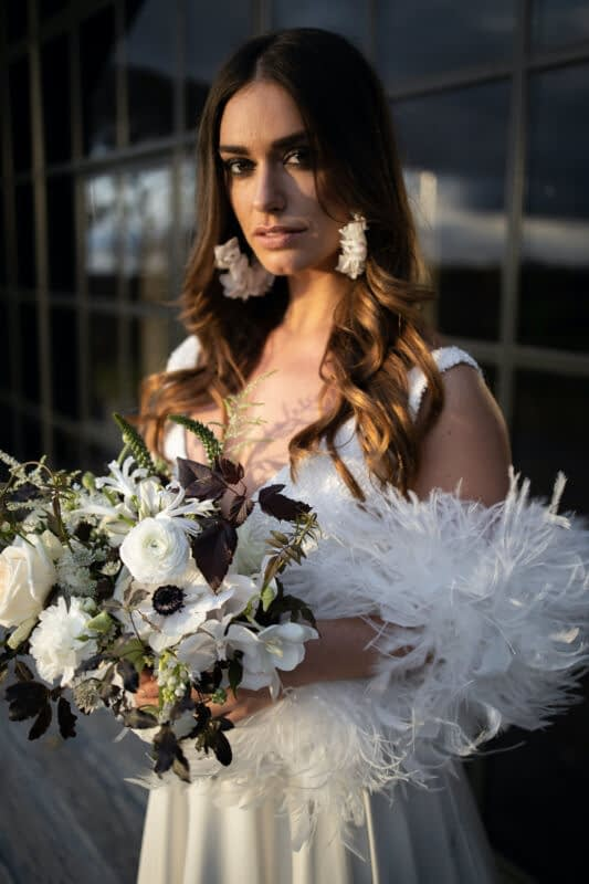 Bride wearing feather boa smokey eyes makeup for a wedding day