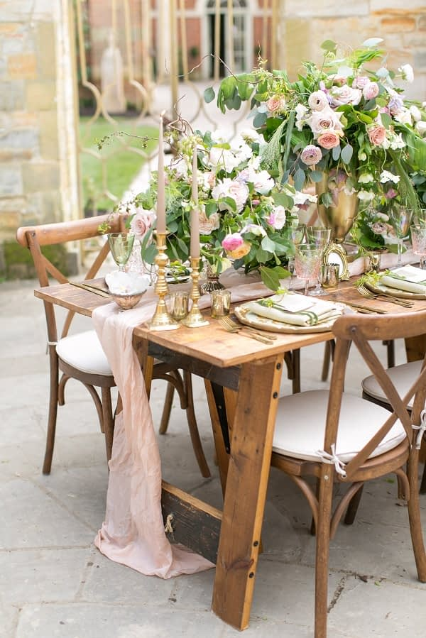 Romantic floral wedding table setup in Hever Castle