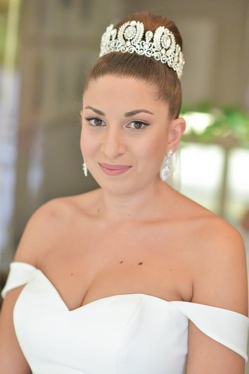 Simple bridal eye makeup rosy lipstick for wedding day top bun for wedding