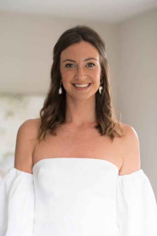 bridal makeup look with nude lips romantic hair down for a wedding bride wearing strapless dress